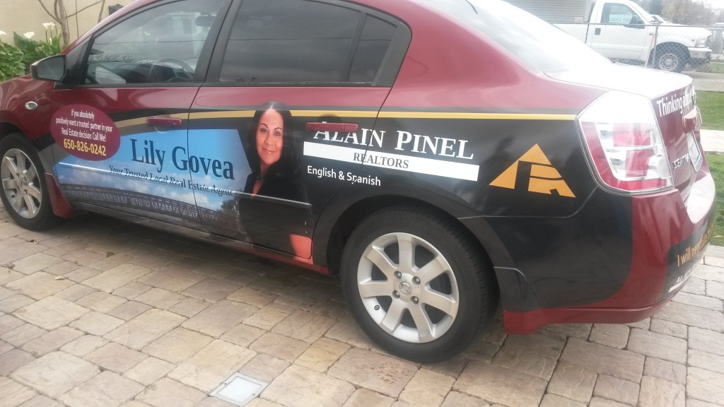 Lily Govea of Alain Pinel Realty Nissan Sentra partial wrap.